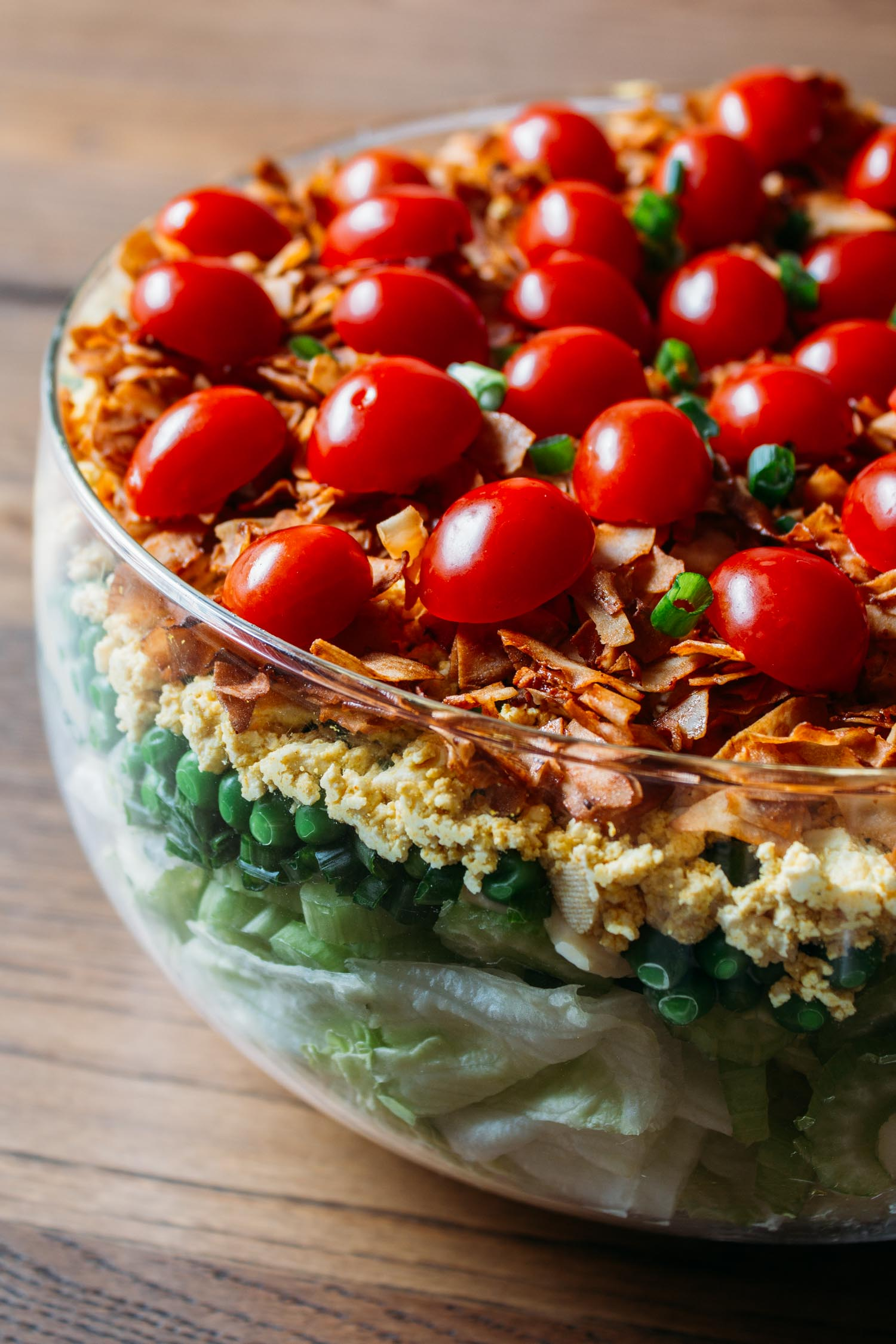 Vegan 7-Layer Salad #salad #meatless #vegan #vegetarian #holidays #entertaining #recipe #Christmas #Thanksgiving #7 Layer #southern #comfort #bacon #tofu #tomatoes #peas #mayonnaise #plant based #gluten free #wfphno #wfpb #side #dairy free