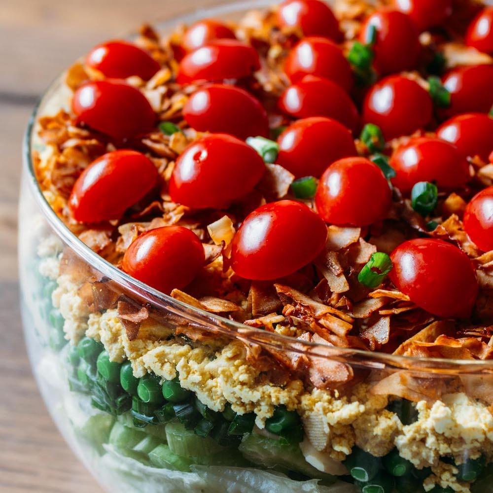 Vegan 7-Layer Salad #salad #meatless #vegan #vegetarian #holidays #entertaining #recipe #Christmas #Thanksgiving #7 Layer #southern #comfort #bacon #tofu #tomatoes #peas #mayonnaise #plant based #gluten free #wfphno #wfpb #side | Veeg