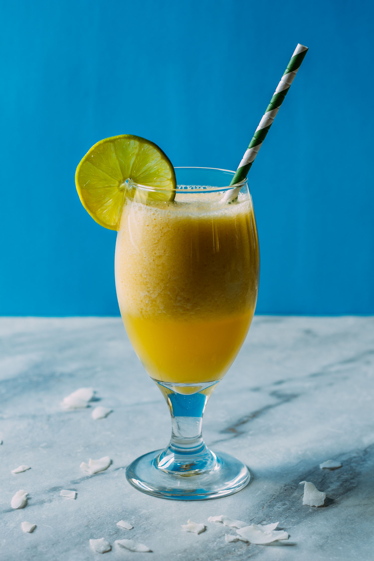 Refreshingly Lite Pina Colada Mango Smoothie #fruit #drink #summertime #recipes #entertaining #wfpb