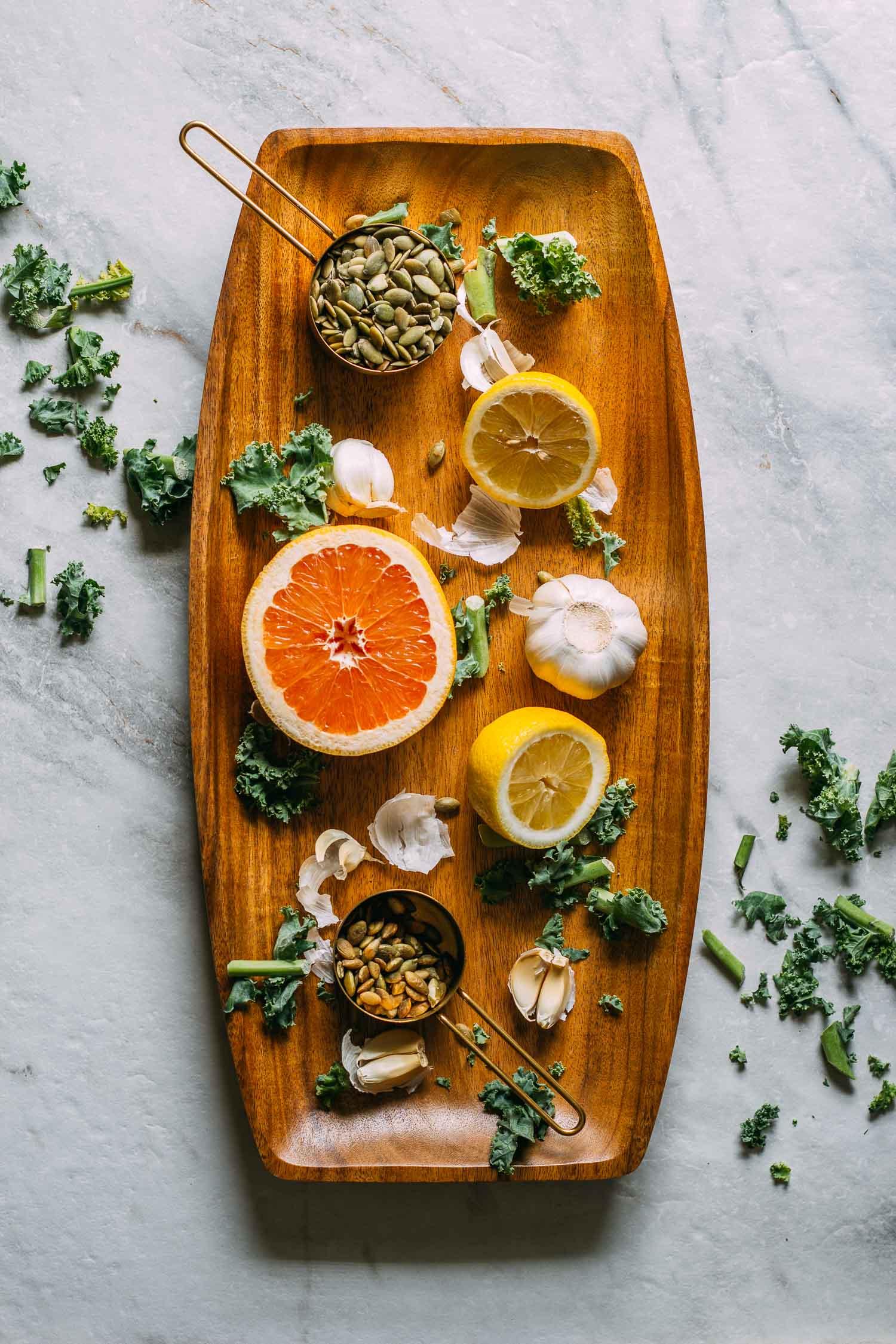 Blueberry Kale Pumpkin Seed Salad #blueberry #pumpkin #seeds #lemon #tahini #citrus #grapefruit #dressing