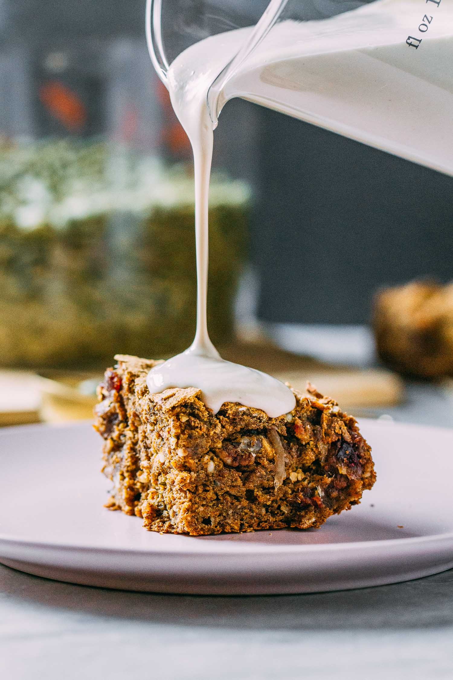 Pumpkin Cinnamon Spice Cake with Cashew Cream Cheese Glaze #pumpkin #cake #cinnamon #spice #cashew #cream #glaze #dairy-free #gluten-free #oil-free #refined sugar-free #plant-based #vegetarian #dessert #breakfast #fall #halloween #harvest #Thanksgiving #Christmas #holidays #recipe #easy #wfpb #recipes #wfpbno #pecans #seeds