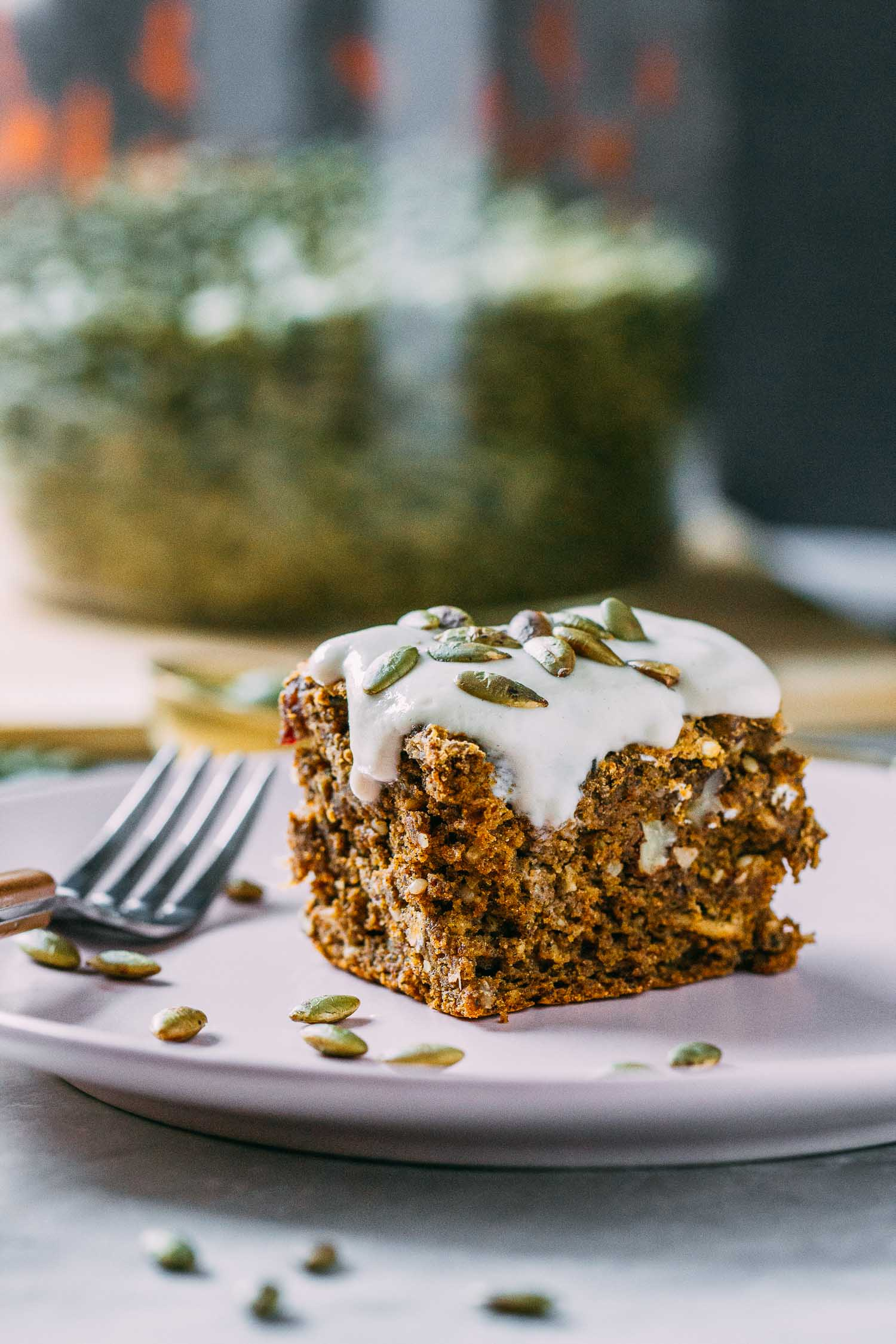 Pumpkin Cinnamon Spice Cake with Cashew Cream Cheese Glaze #pumpkin #cake #cinnamon #spice #cashew #cream #glaze #dairy-free #gluten-free #oil-free #refined sugar-free #plant-based #vegetarian #dessert #breakfast #fall #halloween #harvest #Thanksgiving #Christmas #holidays #recipe #easy #wfpb #recipes #wfpbno #pecans #pumpkin seeds