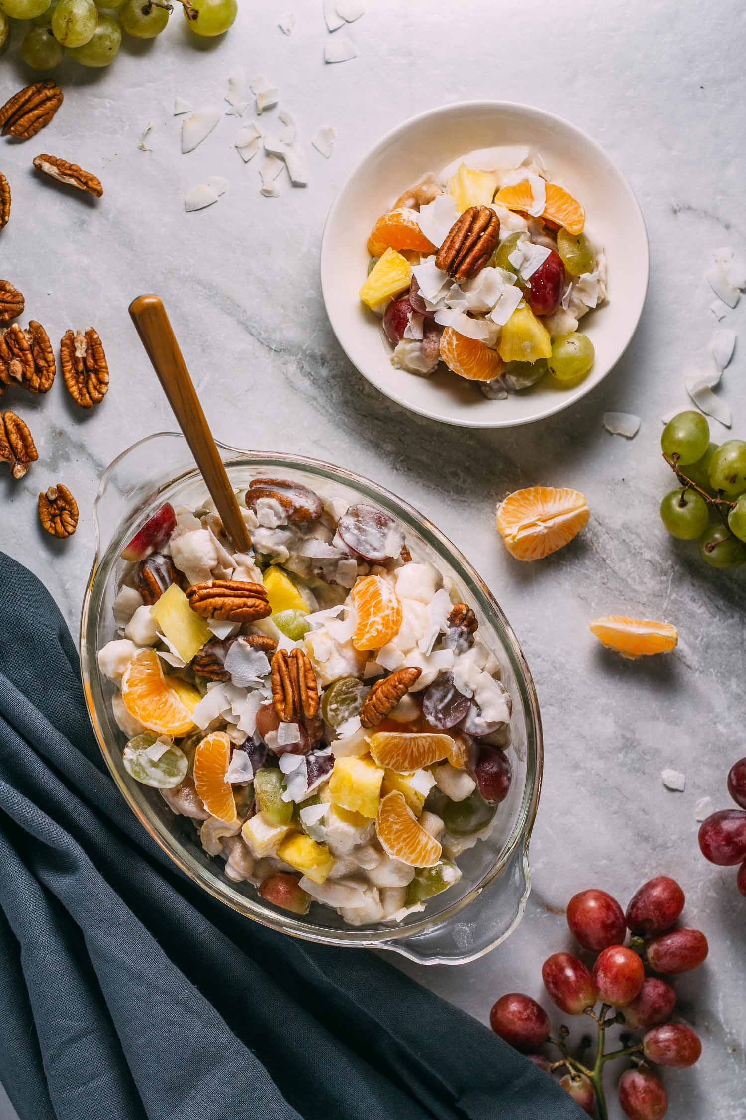 Coconut Ambrosia Fruit Salad #coconut #ambrosia #fruit #salad #dessert #vegan #wfpb #wfpbno #plant-based #vegetarian #Easter #Christmas #Thanksgiving #New Year's #holidays #potluck #throwback #retro #recipe #makeover #make-ahead #gluten-free #dairy-free #refined oil-free #no-oil #recipes #Clementines #pineapple #pecans #cashews #grapes #Dandie's #marshmellows #Kite Hill #dairy-free #yogurt