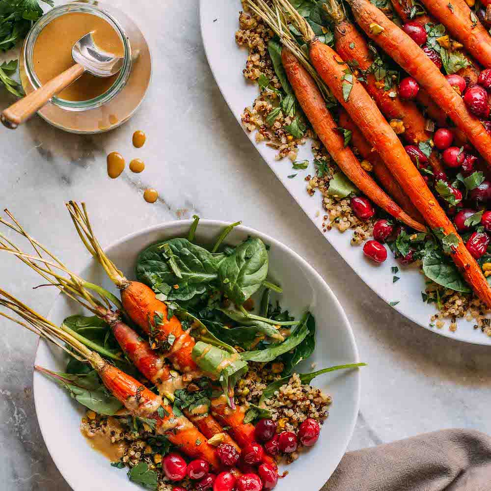 Maple Roasted Carrots and Cranberries with Pistachios #whole food plant based #plant-based #vegan #gluten-free #wfpb #wfpbno #roasted #veggies #maple syrup #cranberries #carrots #lemon #tahini #dressing #quinoa #Spring #greens #Fall #winter #Christmas #Thanksgiving #holiday #buffet #pistachios #vegetables #side dish #entree #bowl #dinner #lunch #recipe #healthy #simple #recipes | Veeg