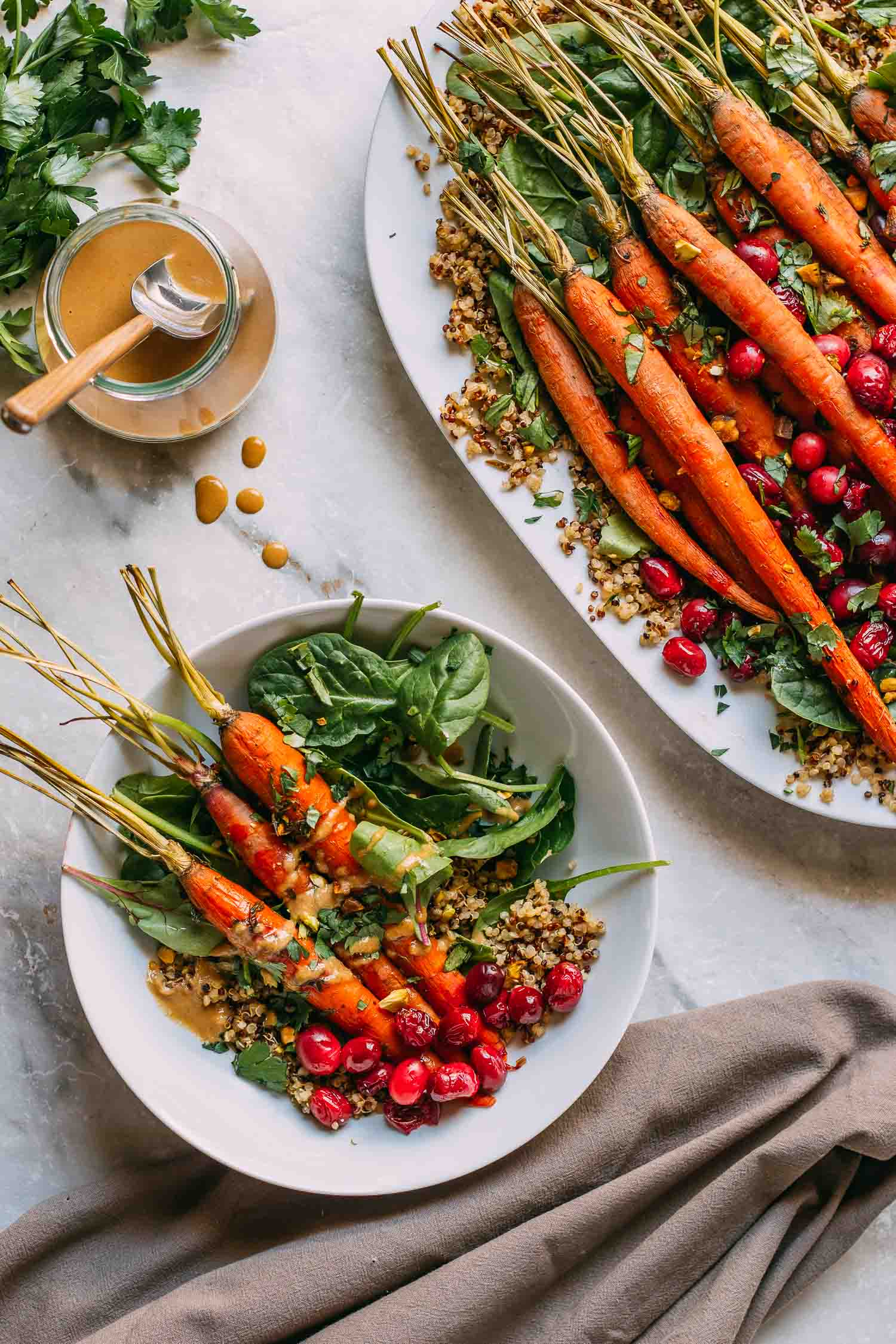 Maple Roasted Carrots and Cranberries with Pistachios #whole food plant based #plant-based #vegan #gluten-free #wfpb #wfpbno #roasted #veggies #maple syrup #cranberries #carrots #lemon #tahini #dressing #quinoa #Spring #greens #Fall #winter #Christmas #Thanksgiving #holiday #buffet #pistachios #vegetables #side dish #entree #bowl #dinner #lunch #recipe #healthy #recipes