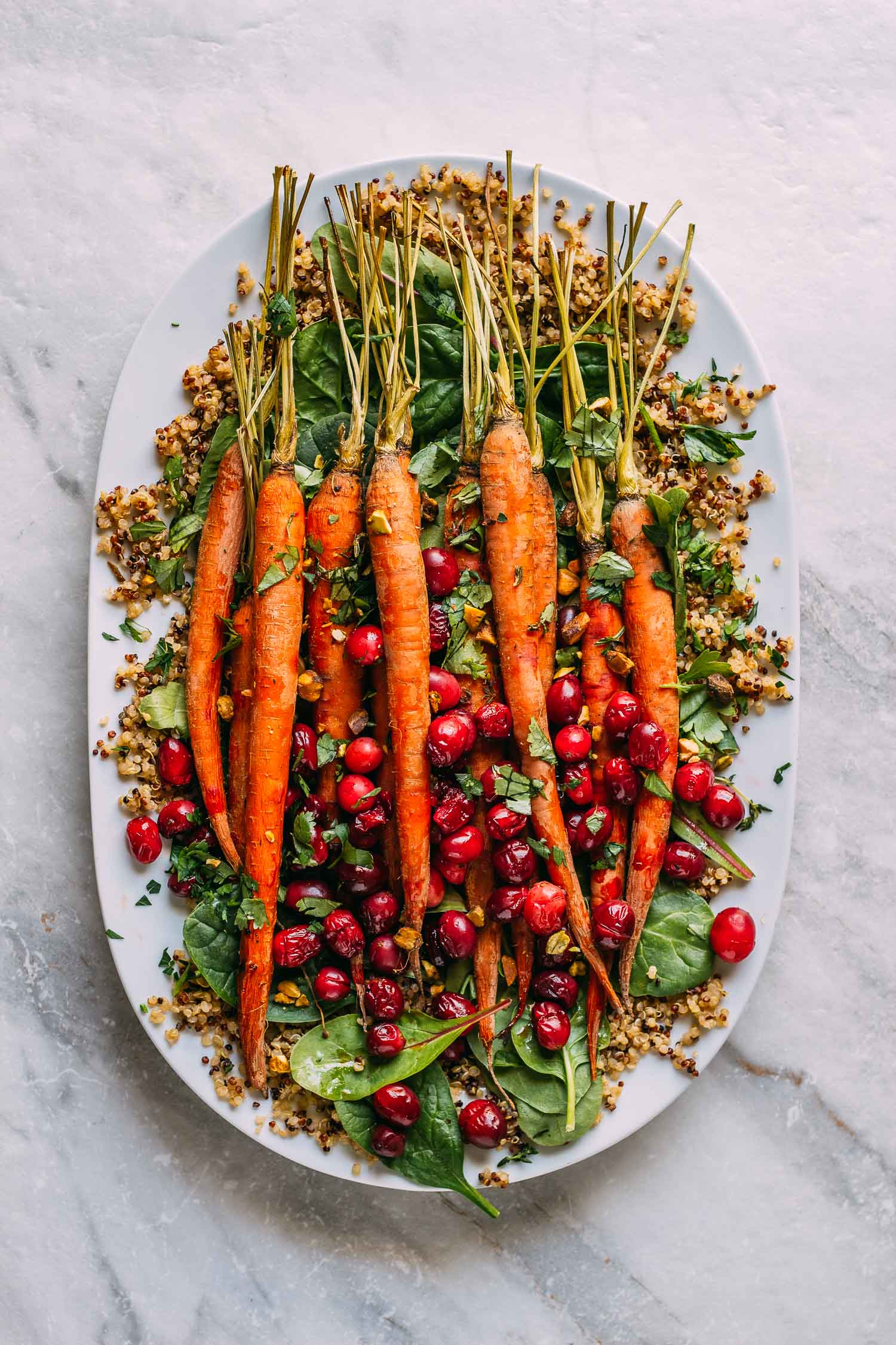 Maple Roasted Carrots and Cranberries with Pistachios #whole food plant based #plant-based #vegan #gluten-free #wfpb #wfpbno #roasted #veggies #maple syrup #cranberries #carrots #lemon #tahini #dressing #quinoa #Spring #greens #Fall #winter #Christmas #Thanksgiving #holiday #buffet #pistachios #vegetables #side dish #entree #bowl #dinner #lunch #recipe #healthy #recipes #thyme #herbs #cilantro #parsley #lemon #marinade