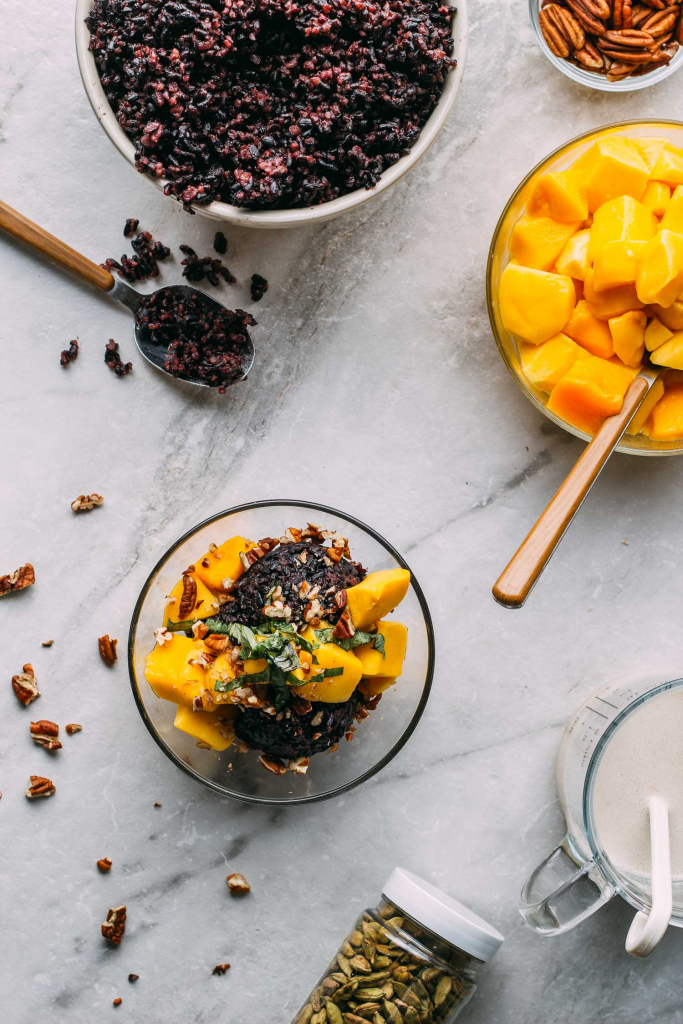 Mango Basil Rice Breakfast or Dessert #mango #rice #breakfast #dessert #snack #healthy #forbiddenrice #basil #pecans #maplesyrup #summertime #kidfriendly #vegan #plantbased #plantbaseddiet #fok #mcdougal #treat #wfpb #wfpbno #vegetarian #orange #black #fall #autumn #herbs #stickyrice #Thai