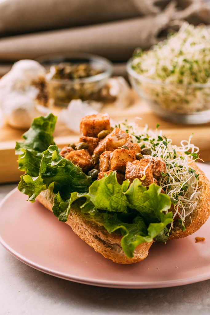 Vegan Tofu Lobster Rolls recipe lettuce sprouts plant-based chunks of tandoori tofu gluten-free sandwich recipe meatless seafood meal oil-free recipes