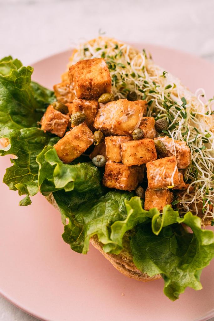 Vegan Tofu Lobster Rolls sandwich recipe pink plate tandoori tofu sprouts lettuce gluten-free sub roll oil-free recipe
