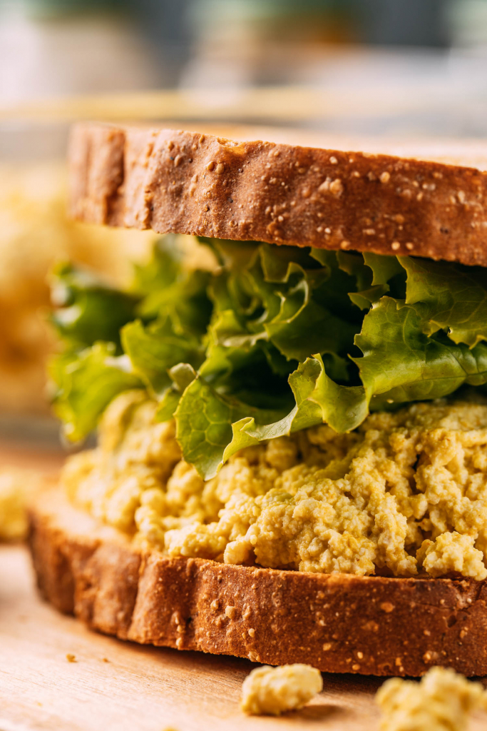 plant-based vegan salad sandwich recipe close up with lettuce on gluten-free bread
