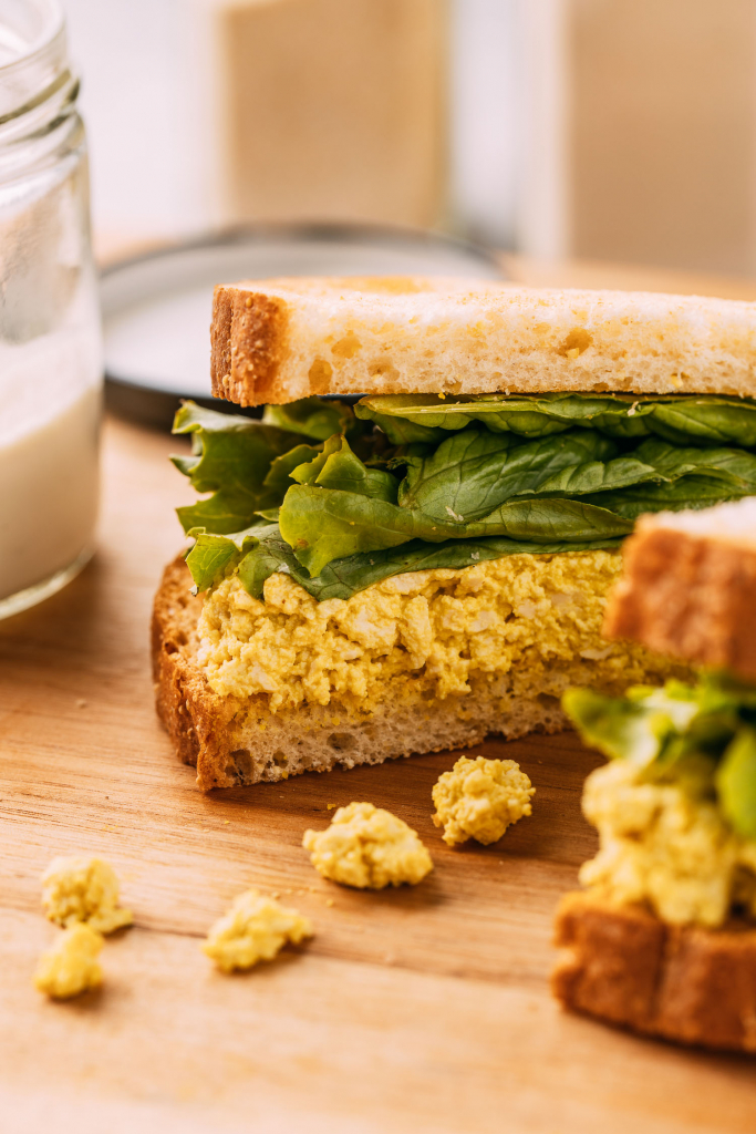 gluten-free egg salad sandwich with lettuce sliced in half