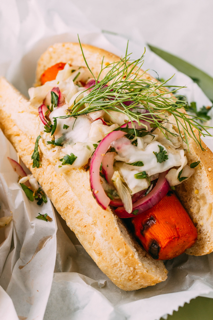 vegan hot dogs with slaw on a plant-based gluten-free bun topped with crazy-good slaw