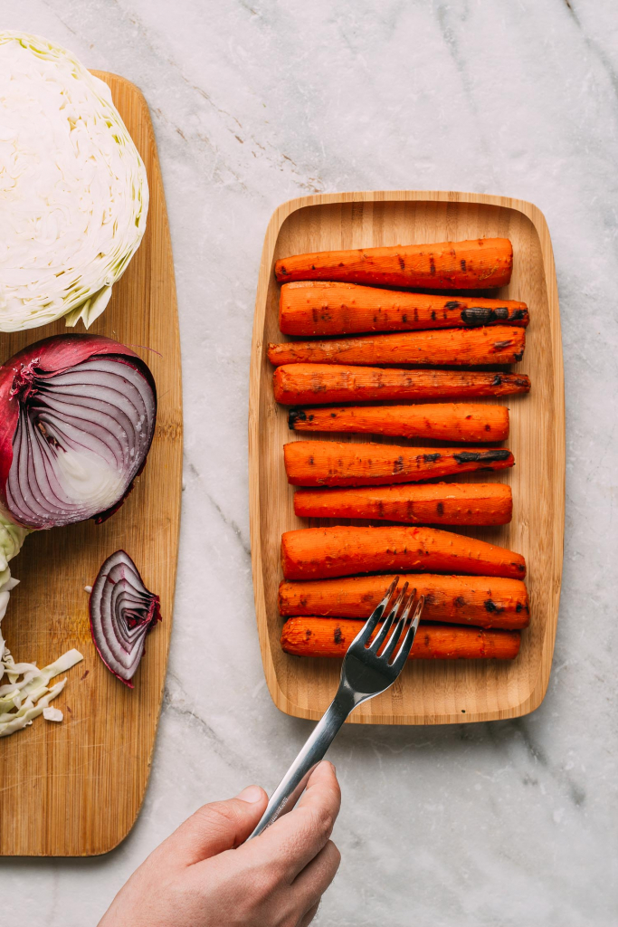 grilled vegan carrot hot dogs soaked in an easy whole food plant based marinade with grill marks
