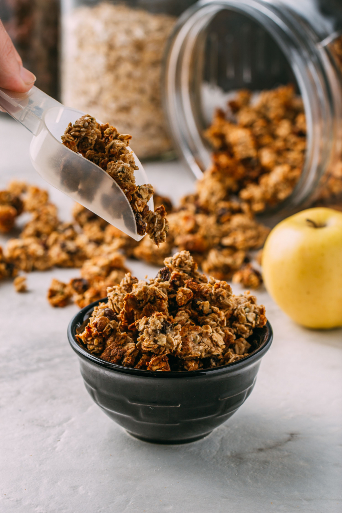 a scoop of granola being served for easy ways to use granola