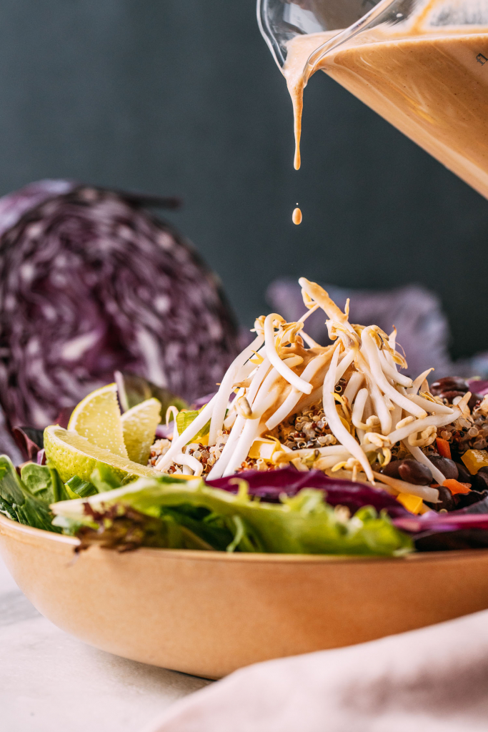 easy thai peanut dressing tops off this crunchy gluten free plant based meal bowl