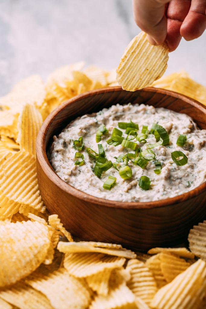 potato chip being dipped in gluten free vegan potato chip dip