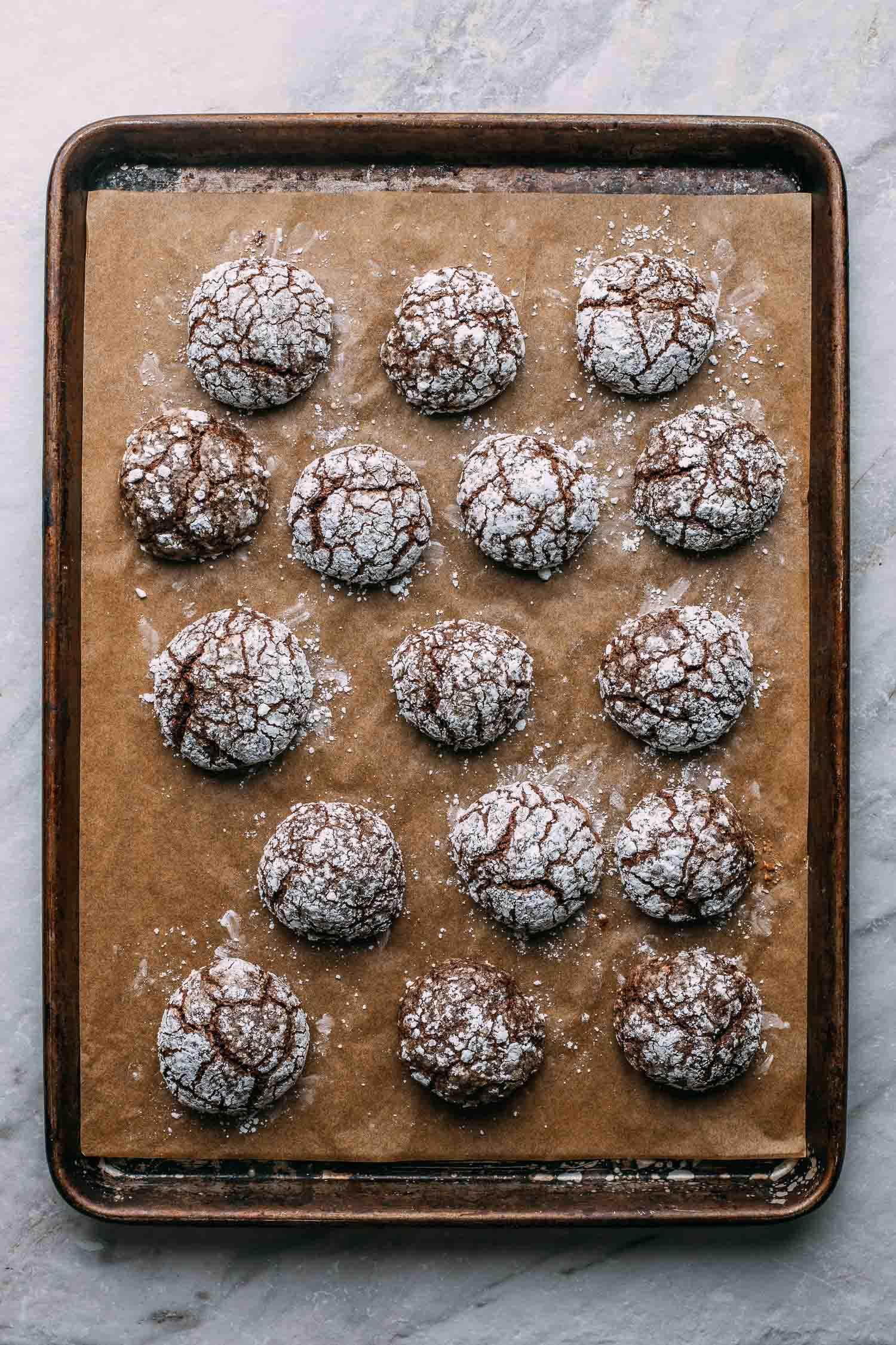 baking pan full of chocolate crinkle cookies gluten free vegan recipe
