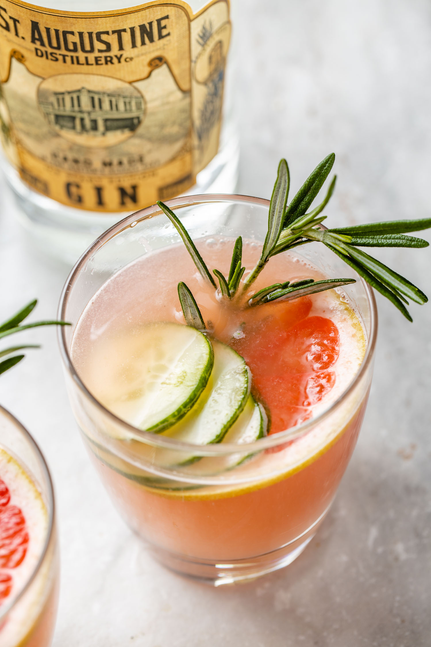 grapefruit seltzer cocktail made with gin infused with fresh rosemary