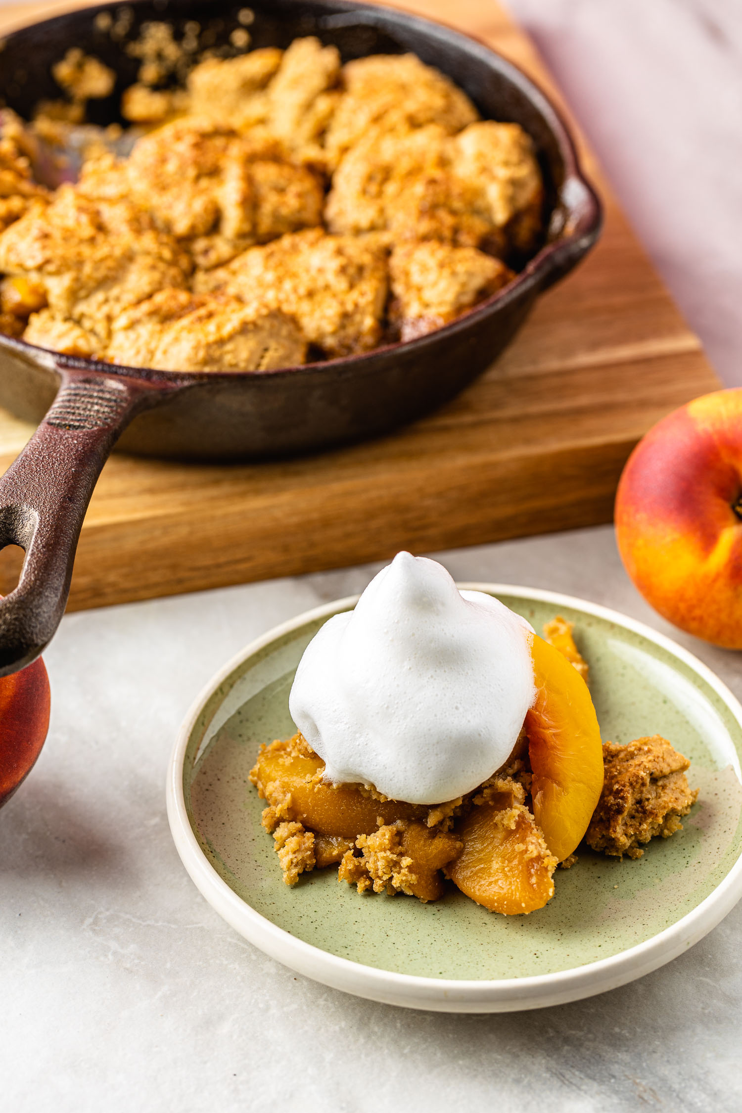 vegan, gluten free peach cobbler  with aquafaba whipped cream