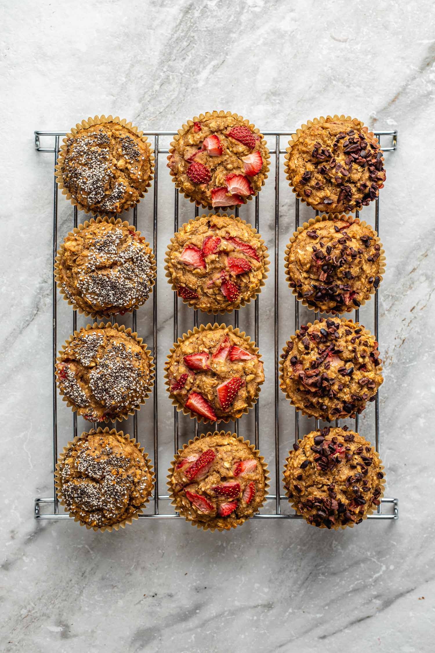one dozen easy vegan, gluten free, muffins sit on a metal cooling rack