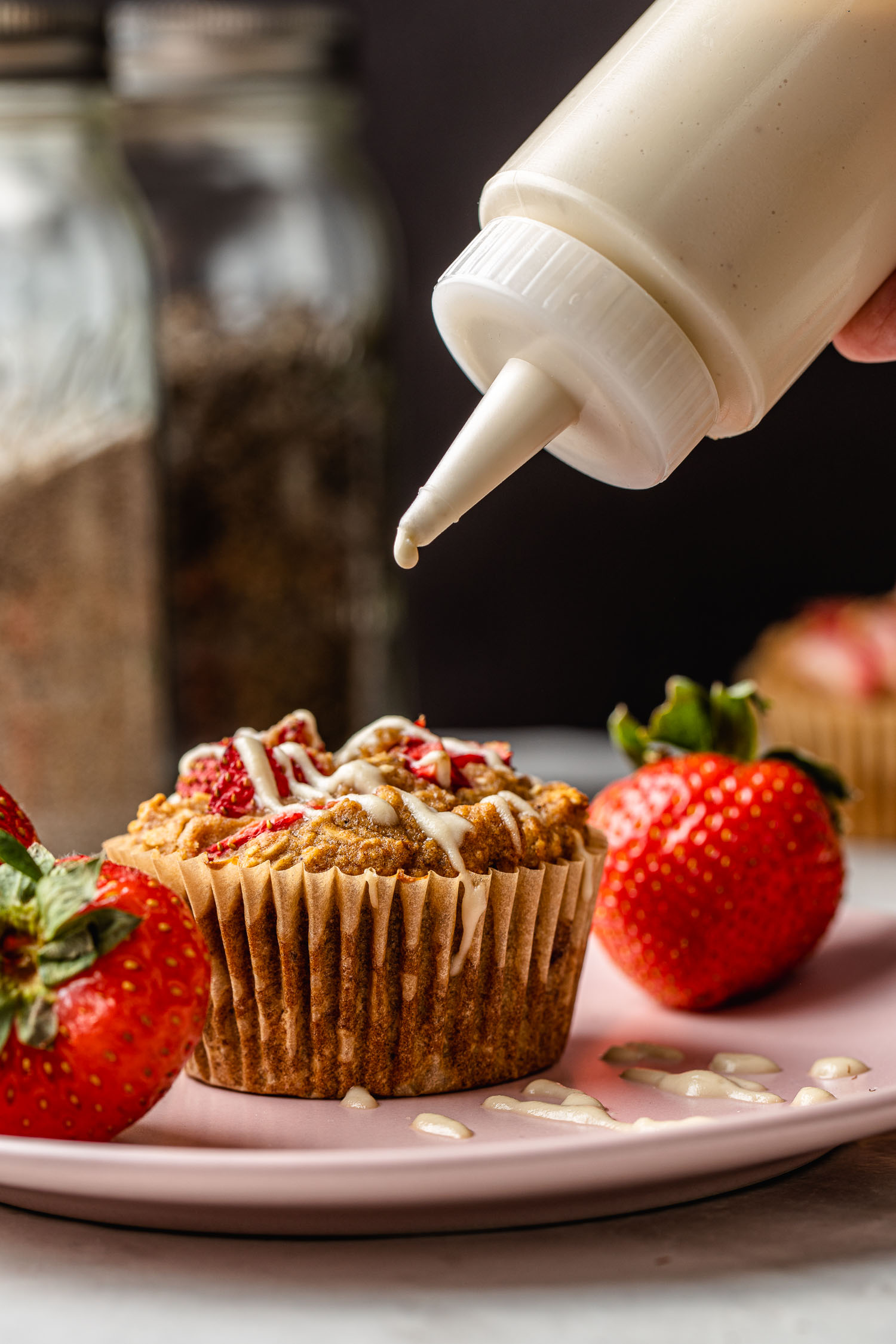 a strawberry muffin gets topped with dairy free cashew cream cheese glaze