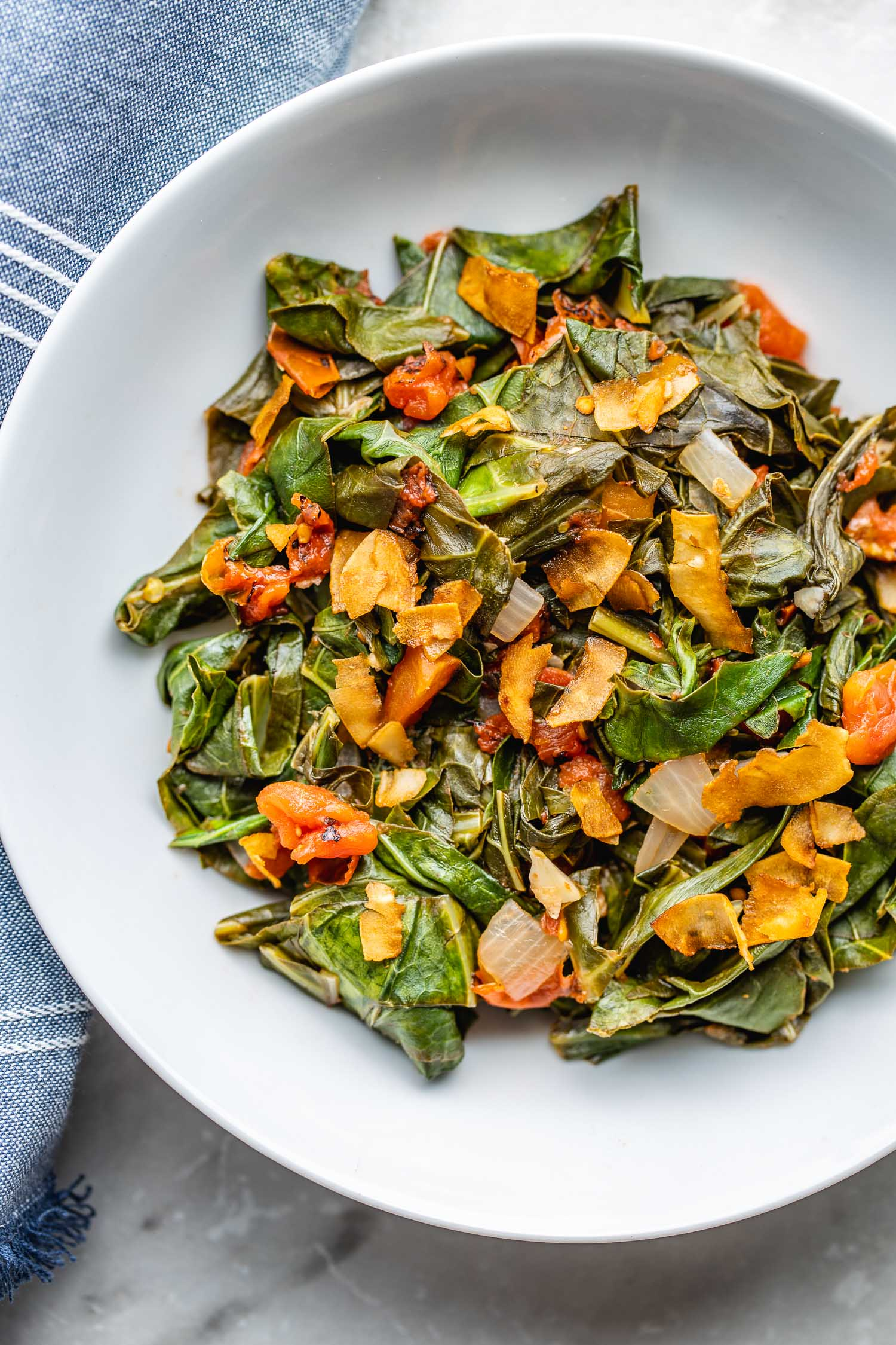 southern-style vegan collard greens in a white bowl