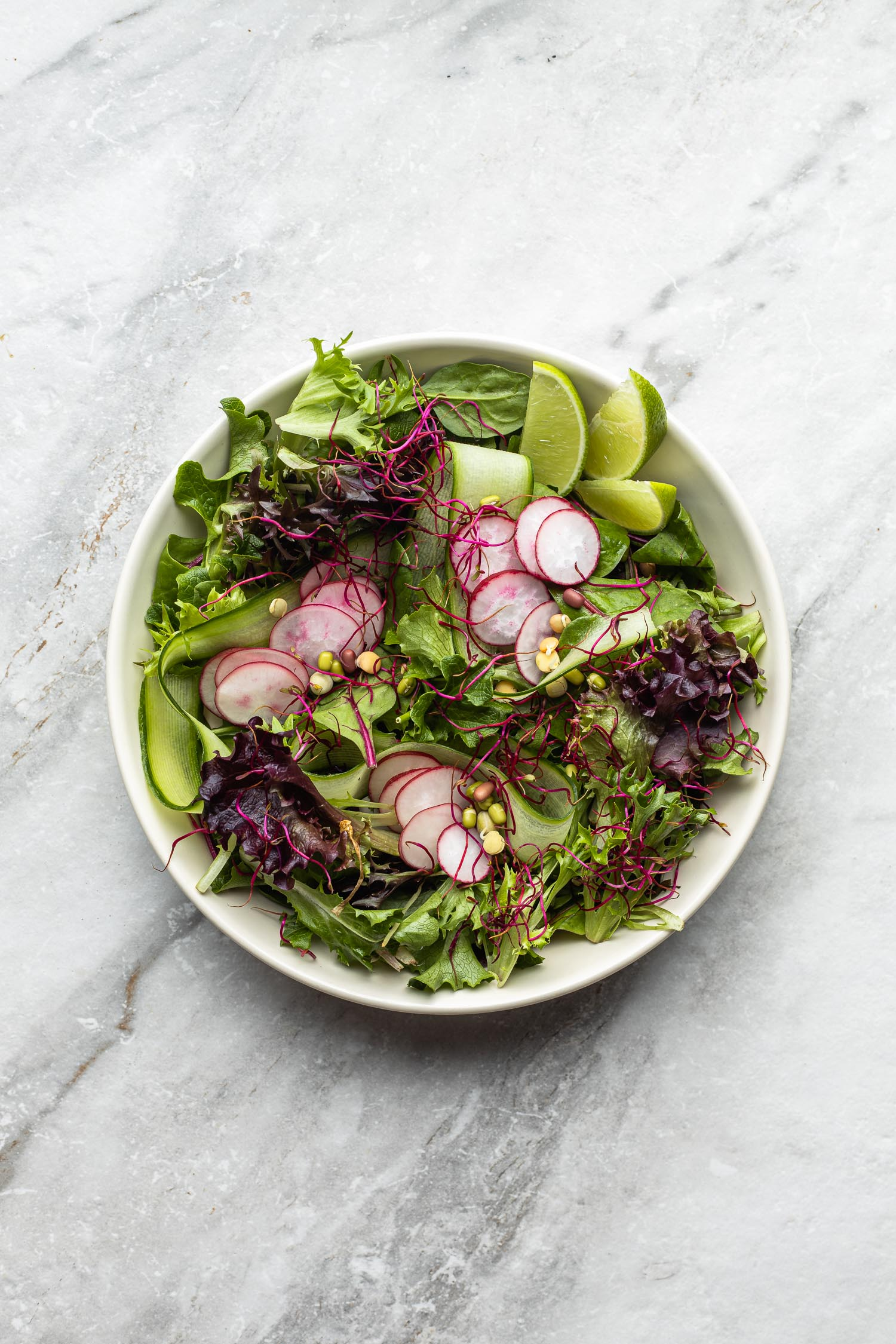 side salad with cucumbers, radish, beet sprouts