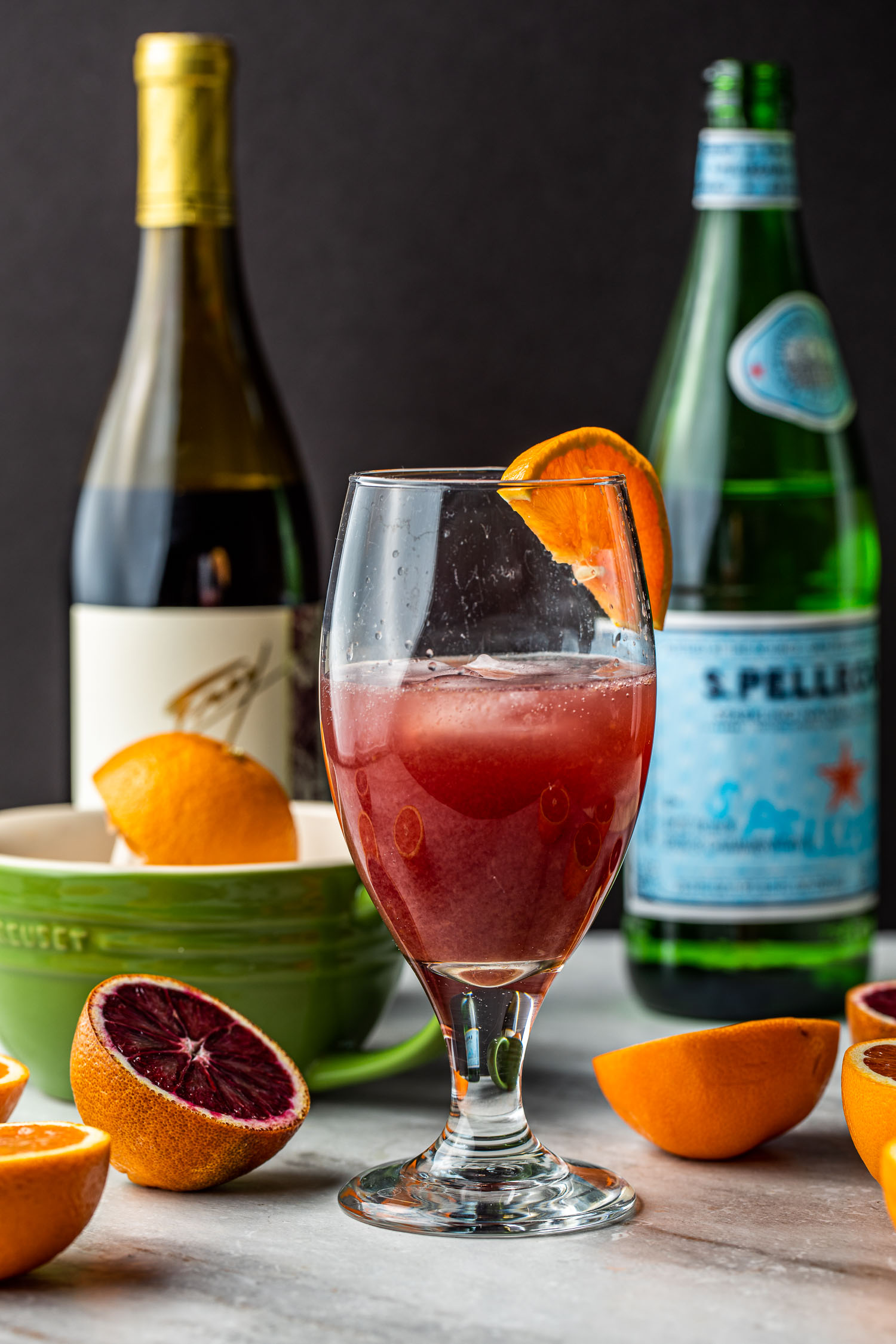 healthy mineral water, orange juice, and red wine cocktail