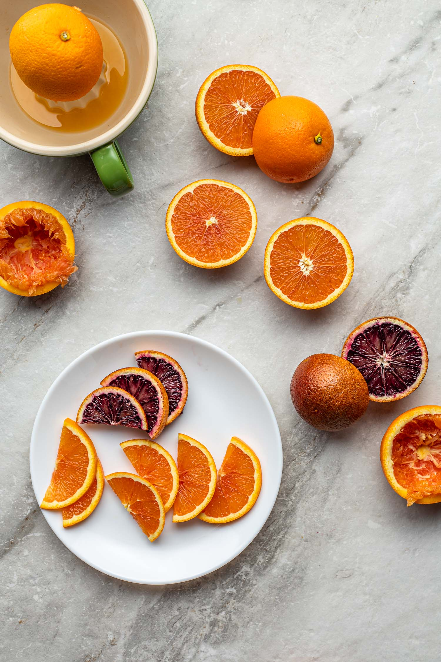blood red oranges and regular oranges sliced to make mixed drinks